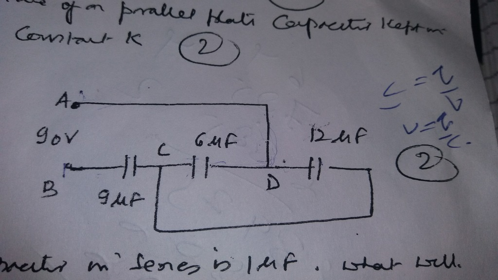 Find the charge on 6 micro farad capacitor in the circuit given
